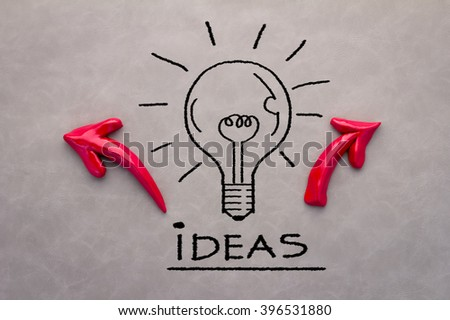 Creative concept with drawing bulb witf arrow on grey background