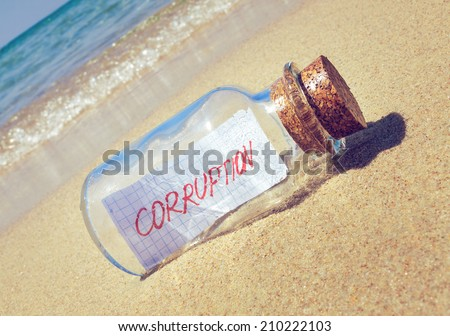 "Creative curruption concept. Message in a bottle with text ""corruption"""