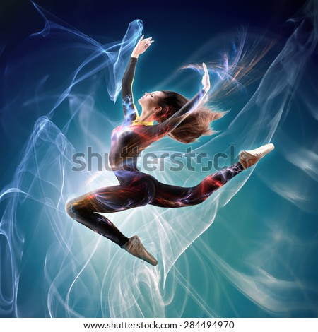 Creative Design. Dancer Jumping With Light Flows Trough Smoke and Sparks - stock photo