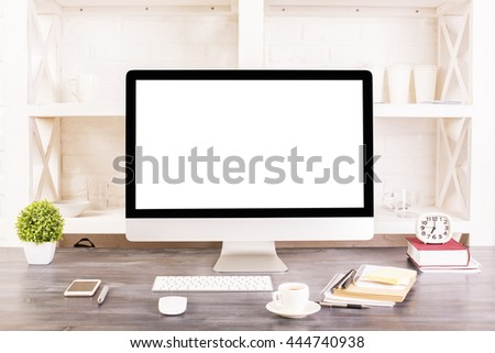 Creative designer desktop with blank white computer monitor, keyboard, stationery items, decorative plant, coffee cup, smartphone and other items with shelves in the background. Mock up - stock photo