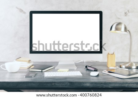 Creative desktop with blank white computer screen and other itmes. Mock up - stock photo