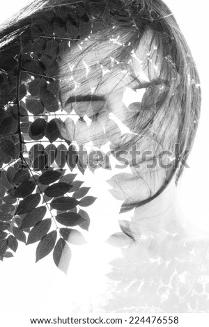 Creative double exposure portrait of attractive woman combined with photograph of leafy tree - stock photo