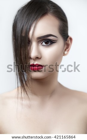 Creative fashion beauty makeup of an attractive young woman.