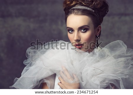 creative fashion shoot with romantic retro atmosphere of sensual elegant girl with precious jewellery, antique dress with frill veil collar and charming make-up  - stock photo