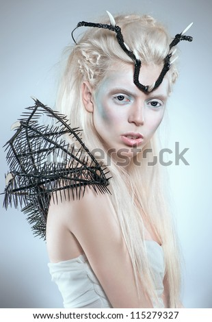 Creative fashion shot with black spikes and crown