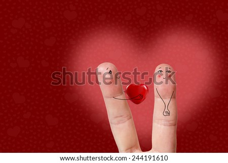 Creative finger art. Happy Valentine's Day, wedding, 8 march, mothers day theme series. Lovers is embracing and holding heart. Stock Image  A happy couple in love with painted smiley and hugging  - stock photo
