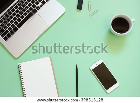 Creative flat lay design of workspace desk with laptop, blank notebook, smartphone, coffee, stationery with copy space background - stock photo
