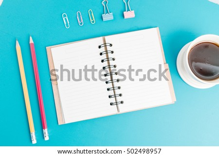 Creative flat lay mockup design of workspace desk with blank notebook, camera, coffee, stationery with copy space background