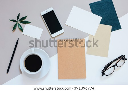 Creative flat lay photo of workspace desk with smartphone, coffee, tag, letter and notebook with copy space background, minimal style - stock photo