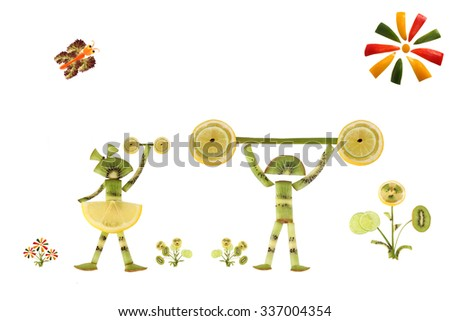 Creative food concept. Children sportsmen made from kiwi - stock photo
