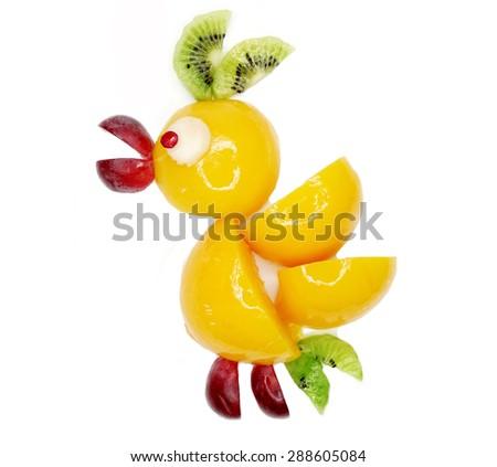 creative fruit dessert for child funny form nestling bird - stock photo