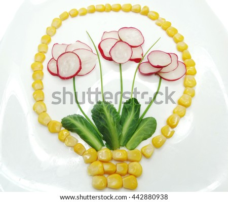 creative funny vegetable food snack with radish flowers in basket - stock photo