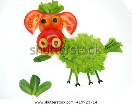 creative funny vegetable food snack with tomato ship form - stock photo