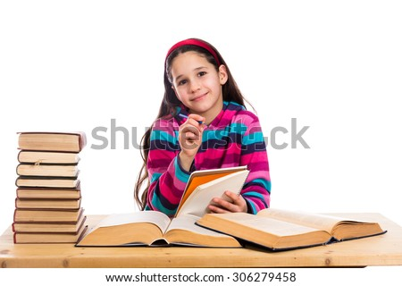 Creative girl with pile of old books, isolated on white - stock photo