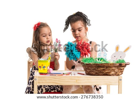Creative girls making Easter decorations isolated on white background - stock photo