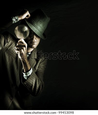 Creative Grunge Portrait Of A Man Holding A Magnifying Glass While On A Search And Find Mission To Solve A Crime Scene Investigation, Isolated On Black