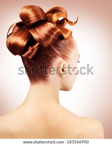 Creative hairstyle on light background - stock photo