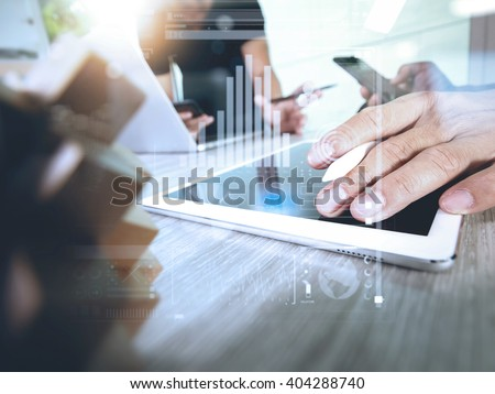 creative hand working digital tablet and wood puzzle with laptop computer and tablet computer as design concept - stock photo