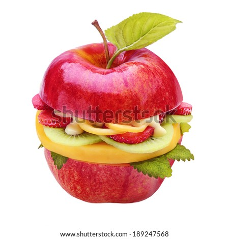 Creative healthy juicy apple burger filled with sliced fresh tropical fruit, strawberries and kiwifruit drizzled with a sauce with a single green leaf for a low calorie snack, isolated on white - stock photo