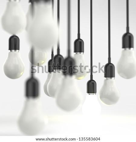 creative idea and leadership concept light bulb on grey background - stock photo