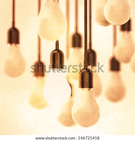 creative idea and leadership concept with growing 3d light bulb as vintage style concept - stock photo