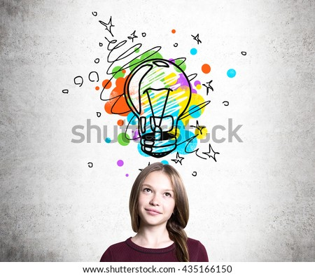 Creative idea concept with thoughtful young woman and colorful lightbulb sketch on concrete background - stock photo