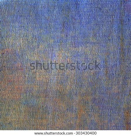 Creative Jeans Texture Background. Blue Yellow Orange color canvas - stock photo