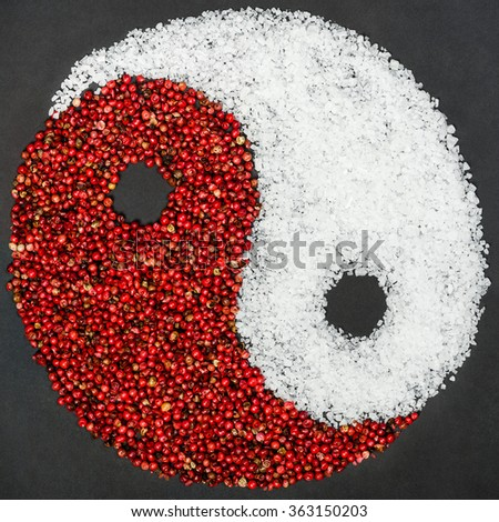 Creative kitchen concept - Yin Yang symbol made from red pepper and salt