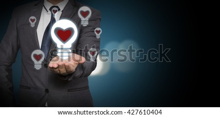 Creative light bulb symbol with heart shape, Idea concept, businessman with ideas and creativity icon.