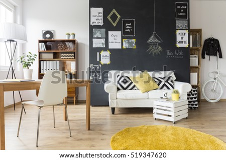 Attractive Creative Living Room With Chalkboard Wall, Wooden Desk And Vintage Furniture
