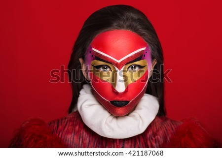 Creative make-up, new conceptual idea for Halloween. Pink red black white golden bold body art painting. Crazy new graphic abstract picture on woman face. Dark lips Horizontal professional photo - stock photo