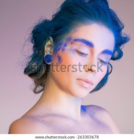 Creative makeup. Blue, indigo makeup. Creative eye make-up, hair - stock photo