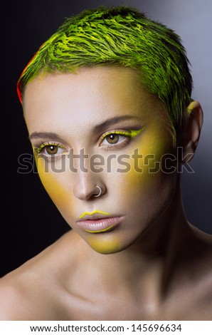 Creative makeup with green hair