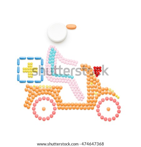 Creative medicine and healthcare concept made of pills, drugs motorbike delivery, isolated on white.