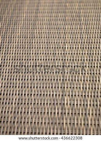 Creative Monochrome Image of a Woven Wicker Background Pattern - stock photo