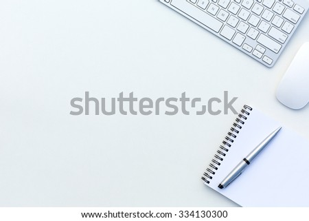 Creative Office Bright Table with Computer Keyboard Mouse Notepad and Executive Pen Top View with Copy Space - stock photo