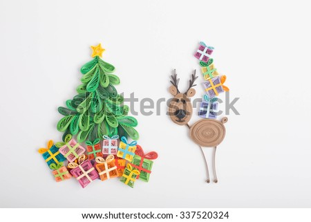 Creative paper Christmas tree and reindeer on a white background. Quilling - stock photo