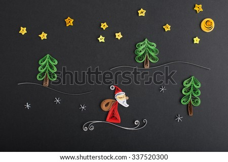 Creative paper Christmas trees and santa on a black background. Quilling - stock photo