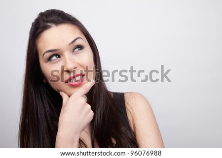 Creative pensive cute woman having an idea