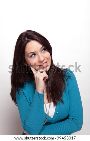 Creative pensive young woman over white