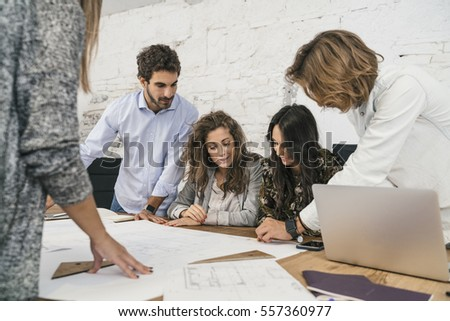 Creative people doing a brainstorming meeting in a modern studio