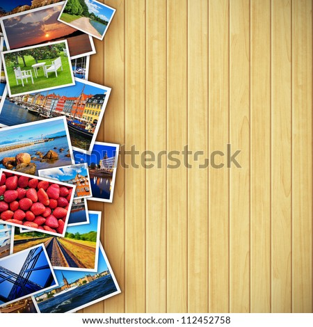 Creative photo gallery concept: collection of colorful photos on background made from wooden planks - stock photo
