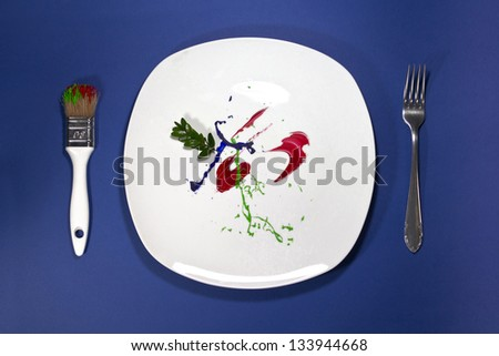 Creative plate with fork and paintbrush - stock photo