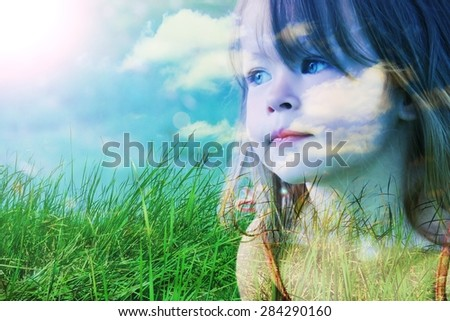 Creative portrait done with trendy double exposure effect. - Young Girl with Grass and sky in one frame. - stock photo