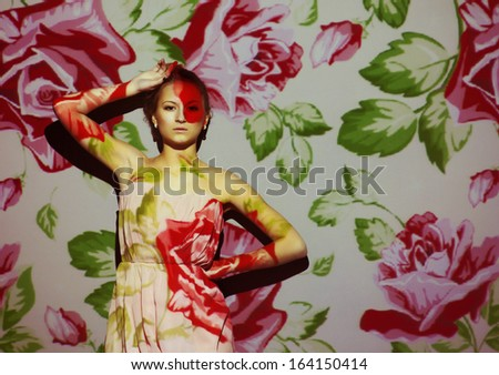 creative portrait, fashion woman with color image on her face - stock photo