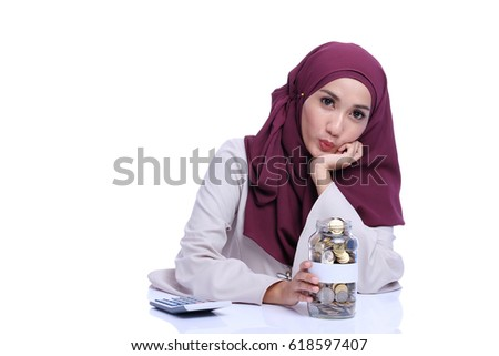Creative portrait of a Asian girl with beautiful face with coins. Financial conceptual or business concept.