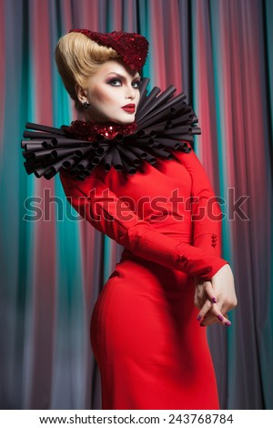 Creative portrait of a beautiful young girl with fashion makeup, and hair in the shape of a heart - stock photo