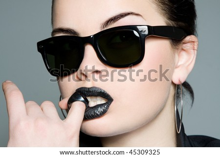 Creative portrait of a sexy strict brunette with a ring - stock photo