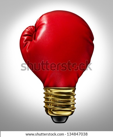 Creative power and Powerful ideas business innovation concept with a red glowing boxing glove shaped as a light bulb representing strong innovative new thinking and competitive imagination. - stock photo