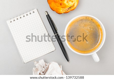 creative process. crumpled wads, blank notebook and cup - stock photo